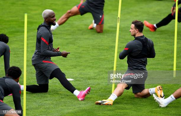Divock Origi and Xherdan Shaqiri of Liverpool during a training session at Melwood Training Ground on September 10 2020 in Liverpool England