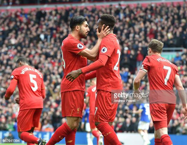 Divock Origi Celebrates the third for Liverpool during the Premier League match between Liverpool and Everton at Anfield on April 1 2017 in Liverpool...