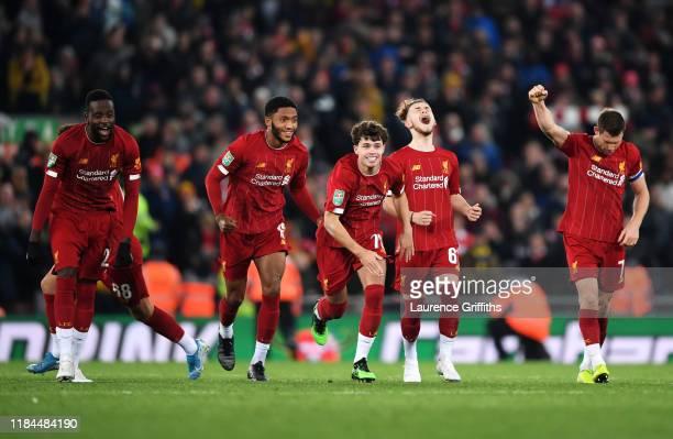 Divock Origi, Joe Gomez, Neco Williams, Harvey Elliott and James Milner of Liverpool celebrate victory after Curtis Jones of Liverpool scores his...