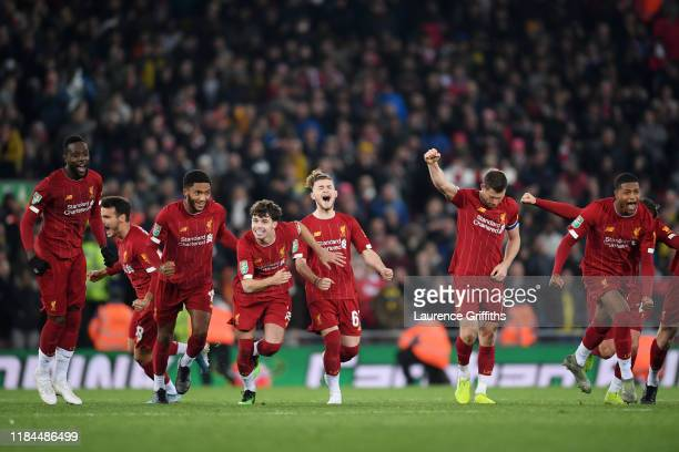 Divock Origi Joe Gomez Neco Williams Harvey Elliott James Milner and Rhian Brewster of Liverpool celebrate victory after Curtis Jones of Liverpool...