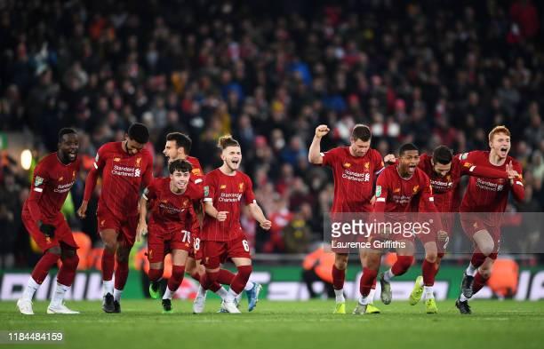 Divock Origi, Joe Gomez, Neco Williams, Harvey Elliott, James Milner, Rhian Brewster, Adam Lallana and Sepp Van Den Berg of Liverpool celebrate...