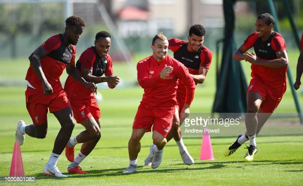 Divock Origi Nathaneil Clyne Xherdan Shaqiri Dominic Solanke and Joel Matip of Liverpool during a training session at Melwood Training Ground on...
