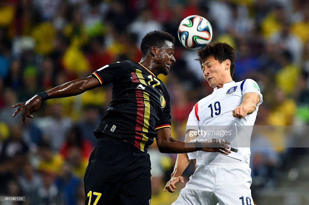 Divock Origi of Belgium and Ji Dong-Won of South Korea compete for the ball during the 2014 FIFA World Cup Brazil Group H match between Korea Republic and Belgium at Arena de Sao Paulo on June 26, 2014 in Sao Paulo, Brazil.
