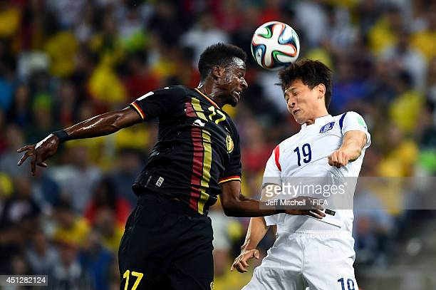 Divock Origi of Belgium and Ji Dong-Won of South Korea compete for the ball during the 2014 FIFA World Cup Brazil Group H match between Korea...