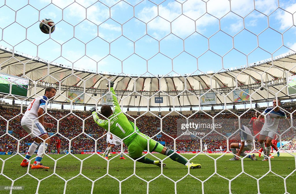 Divock Origi of Belgium scores his team's first goal past Igor Akinfeev of Russia during the 2014 FIFA World Cup Brazil Group H match between Belgium and Russia at Maracana on June 22, 2014 in Rio de Janeiro, Brazil.