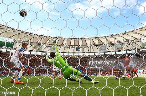 Divock Origi of Belgium scores his team's first goal past Igor Akinfeev of Russia during the 2014 FIFA World Cup Brazil Group H match between Belgium...