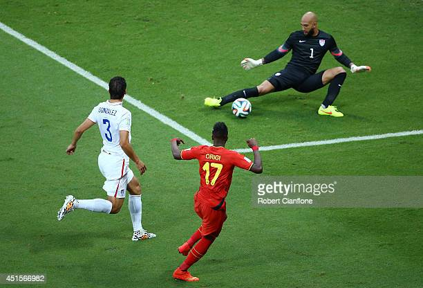 Divock Origi of Belgium shoots against Tim Howard of the United States during the 2014 FIFA World Cup Brazil Round of 16 match between Belgium and...