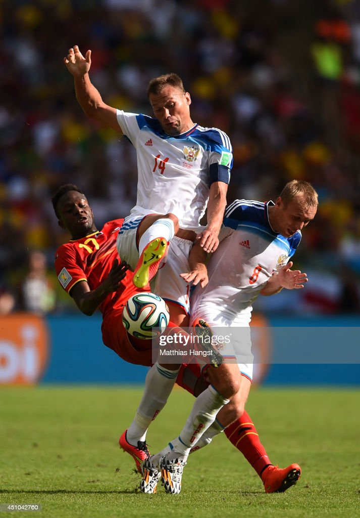 Divock Origi of Belgium, Vasily Berezutskiy and Denis Glushakov of Russia clash during the 2014 FIFA World Cup Brazil Group H match between Belgium and Russia at Maracana on June 22, 2014 in Rio de Janeiro, Brazil.