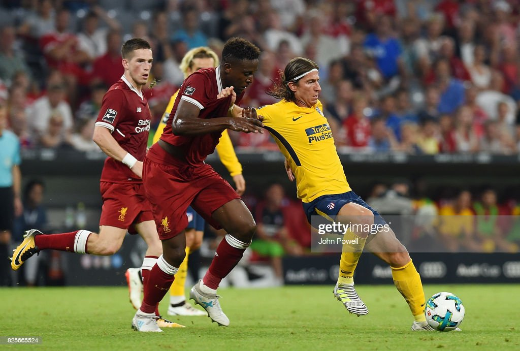 Divock Origi of Liveprool and Filipe Luis of Atletico Madrid during the Audi Cup 2017 match between Liverpool FC and Atletico Madrid at Allianz Arena on August 2, 2017 in Munich, Germany.