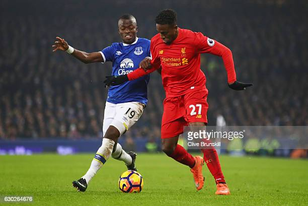 Divock Origi of Liverpool and Enner Valencia of Everton battle for the ball during the Premier League match between Everton and Liverpool at Goodison...