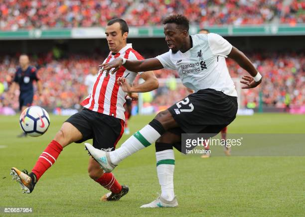 Divock Origi of Liverpool and Inigo Lekue of Athletic Club battle for possession during the Pre Season Friendly match between Liverpool and Athletic...