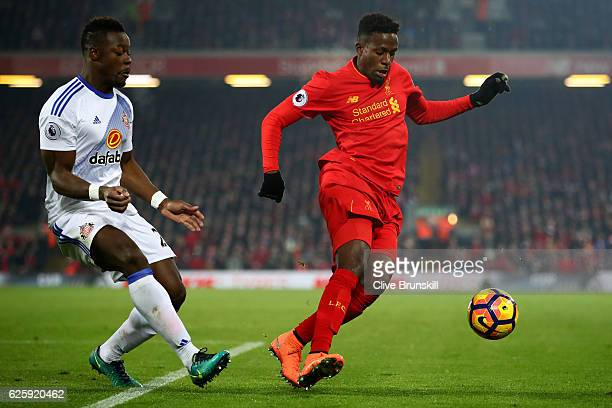 Divock Origi of Liverpool and Lamine Kone of Sunderland compete for the ball during the Premier League match between Liverpool and Sunderland at...