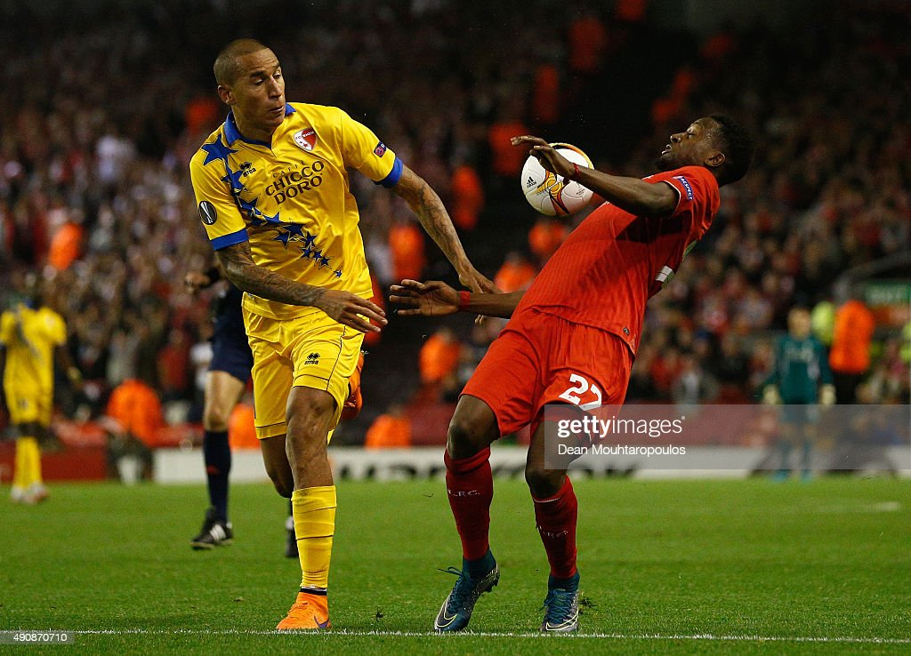Divock Origi of Liverpool and Leo Lacroix of FC Sion compete for the ball during the UEFA Europa League group B match between Liverpool FC and FC Sion at Anfield on October 1, 2015 in Liverpool, United Kingdom.