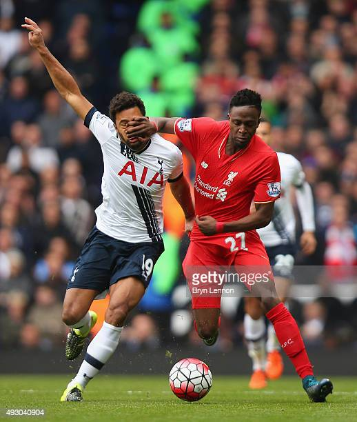 Divock Origi of Liverpool and Mousa Dembele of Tottenham Hotspur compete for the ball during the Barclays Premier League match between Tottenham...