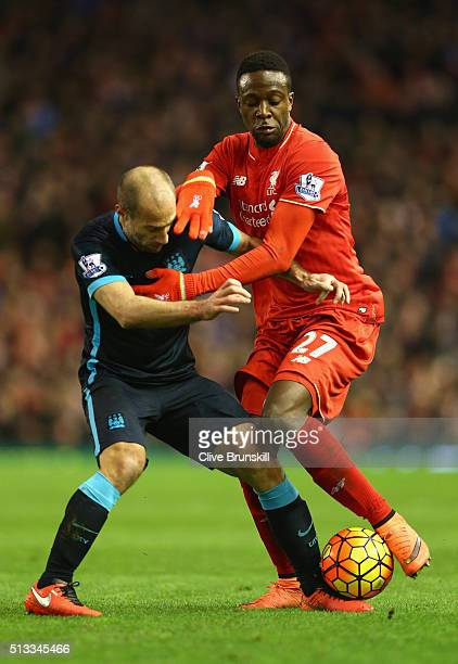Divock Origi of Liverpool and Pablo Zabaleta of Manchester City challenge for the ball during the Barclays Premier League match between Liverpool and...
