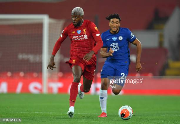 Divock Origi of Liverpool and Reece James of Chelsea chase the ball during the Premier League match between Liverpool FC and Chelsea FC at Anfield on...
