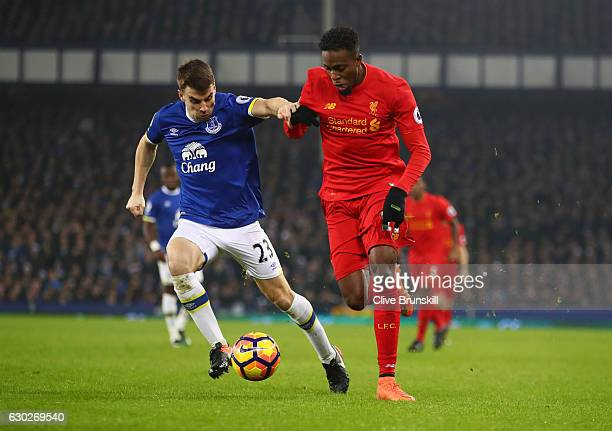 Divock Origi of Liverpool and Seamus Coleman of Everton battle for the ball during the Premier League match between Everton and Liverpool at Goodison...