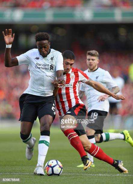 Divock Origi of Liverpool and Unai Nunez of Athletic Club battle for possession during the Pre Season Friendly match between Liverpool and Athletic...