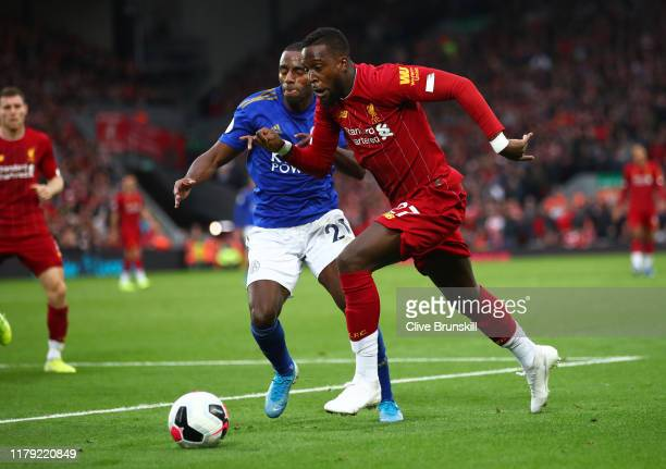 Divock Origi of Liverpool battles for possession with Ricardo Pereira of Leicester City during the Premier League match between Liverpool FC and...