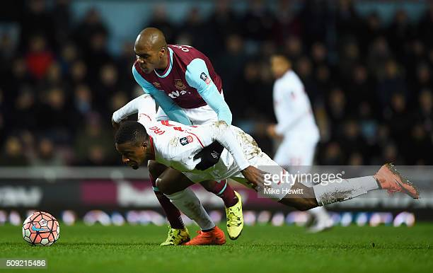 Divock Origi of Liverpool battles with Angelo Ogbonna Obinza of West Ham United during the Emirates FA Cup Fourth Round Replay match between West Ham...