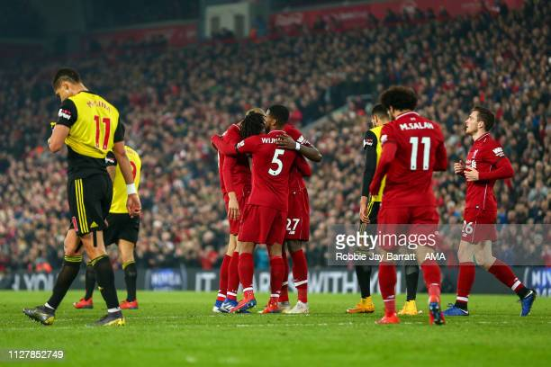 Divock Origi of Liverpool celebrates after scoring a goal to make it 30 during the Premier League match between Liverpool FC and Watford FC at...