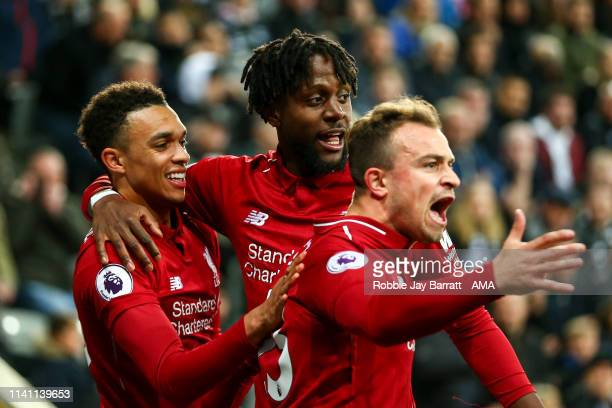 Divock Origi of Liverpool celebrates after scoring a goal to make it 23 during the Premier League match between Newcastle United and Liverpool FC at...