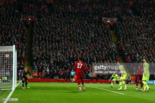 Divock Origi of Liverpool celebrates after scoring a goal to make it 40 during the UEFA Champions League Semi Final second leg match between...