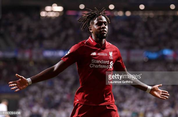 Divock Origi of Liverpool celebrates after scoring his sides second goal during the UEFA Champions League Final between Tottenham Hotspur and...