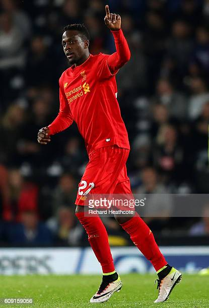Divock Origi of Liverpool celebrates after scoring his sids third goal during the EFL Cup Third Round match between Derby County and Liverpool at...