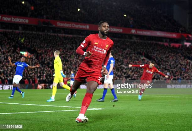 Divock Origi of Liverpool celebrates after scoring his team's first goal during the Premier League match between Liverpool FC and Everton FC at...