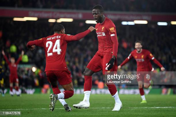 Divock Origi of Liverpool celebrates after scoring his team's fourth goal with Rhian Brewster of Liverpool during the Carabao Cup Round of 16 match...