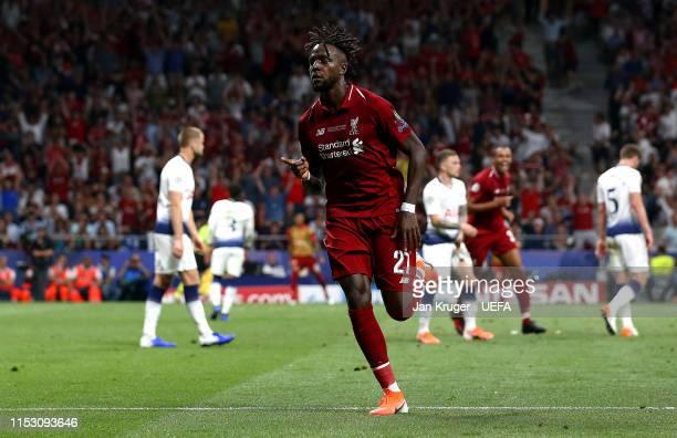 Divock Origi of Liverpool celebrates after scoring his team's second goal during the UEFA Champions League Final between Tottenham Hotspur and...