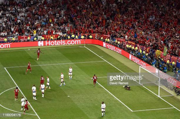 Divock Origi of Liverpool celebrates after scoring his team's second goal during the UEFA Champions League Final between Tottenham Hotspur and...