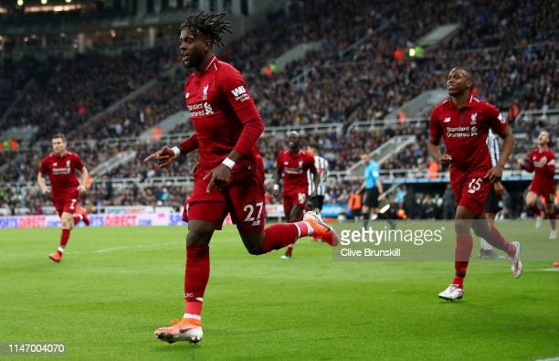 Divock Origi of Liverpool celebrates after scoring his team's third goal during the Premier League match between Newcastle United and Liverpool FC at...
