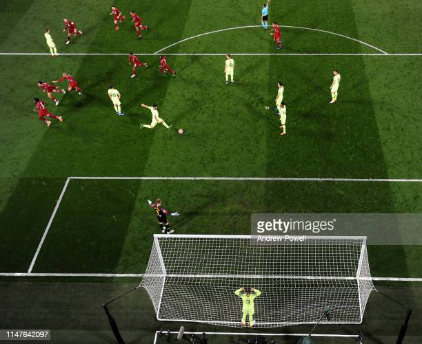 Divock Origi of Liverpool celebrates after scoring the fourth goal during the UEFA Champions League Semi Final second leg match between Liverpool and...