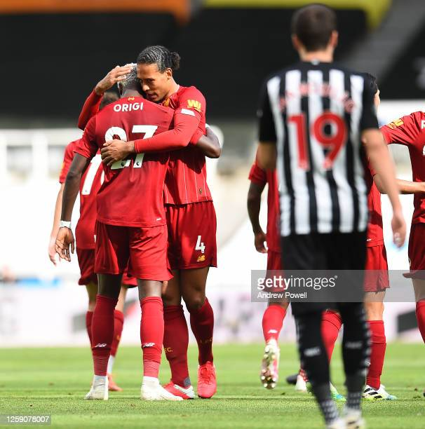 Divock Origi of Liverpool celebrates after scoring the second goal during the Premier League match between Newcastle United and Liverpool FC at St...