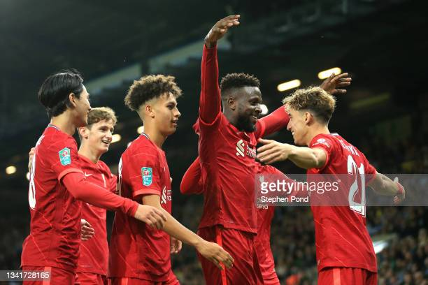 Divock Origi of Liverpool celebrates after scoring their sides second goal with team mate Kostas Tsimikas during the Carabao Cup Third Round match...