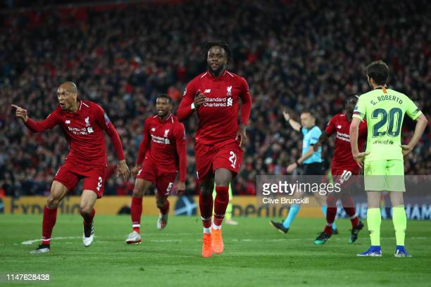 Divock Origi of Liverpool celebrates as he scores his team's fourth goal with Fabinho during the UEFA Champions League Semi Final second leg match...