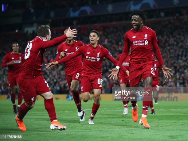 Divock Origi of Liverpool celebrates as he scores his team's fourth goal with team mates during the UEFA Champions League Semi Final second leg match...