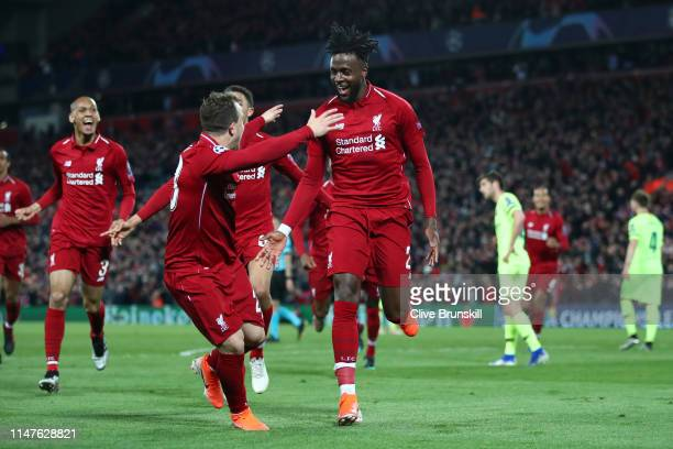 Divock Origi of Liverpool celebrates as he scores his team's fourth goal with Xherdan Shaqiri and team mates during the UEFA Champions League Semi...