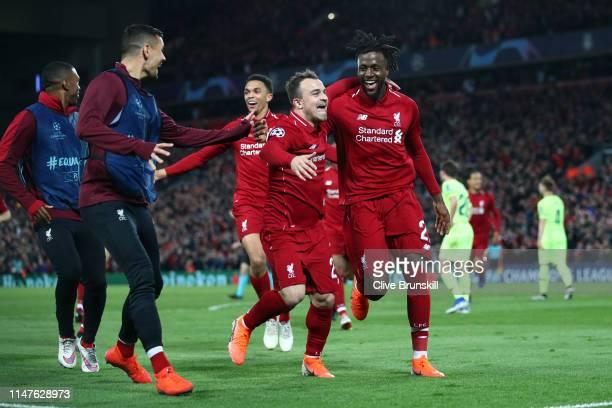 Divock Origi of Liverpool celebrates as he scores his team's fourth goal with Xherdan Shaqiri and team mates during the UEFA Champions League Semi...