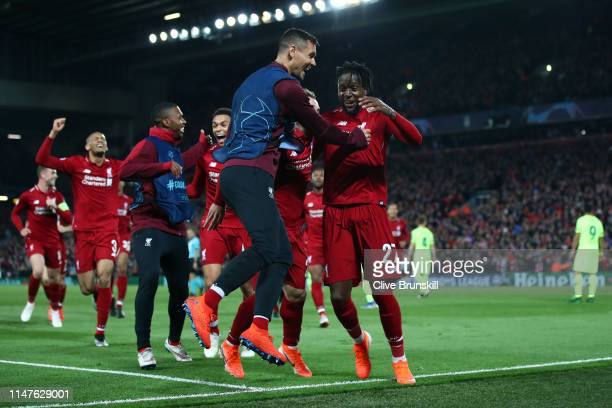 Divock Origi of Liverpool celebrates as he scores his team's fourth goal with Dejan Lovren and team mates during the UEFA Champions League Semi Final...