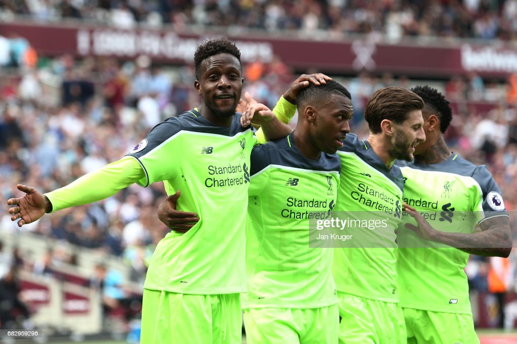 Divock Origi of Liverpool celebrates scoring his sides fourth goal with Daniel Sturridge of Liverpool and Adam Lallana of Liverpool during the Premier League match between West Ham United and Liverpool at London Stadium on May 14, 2017 in Stratford, England.
