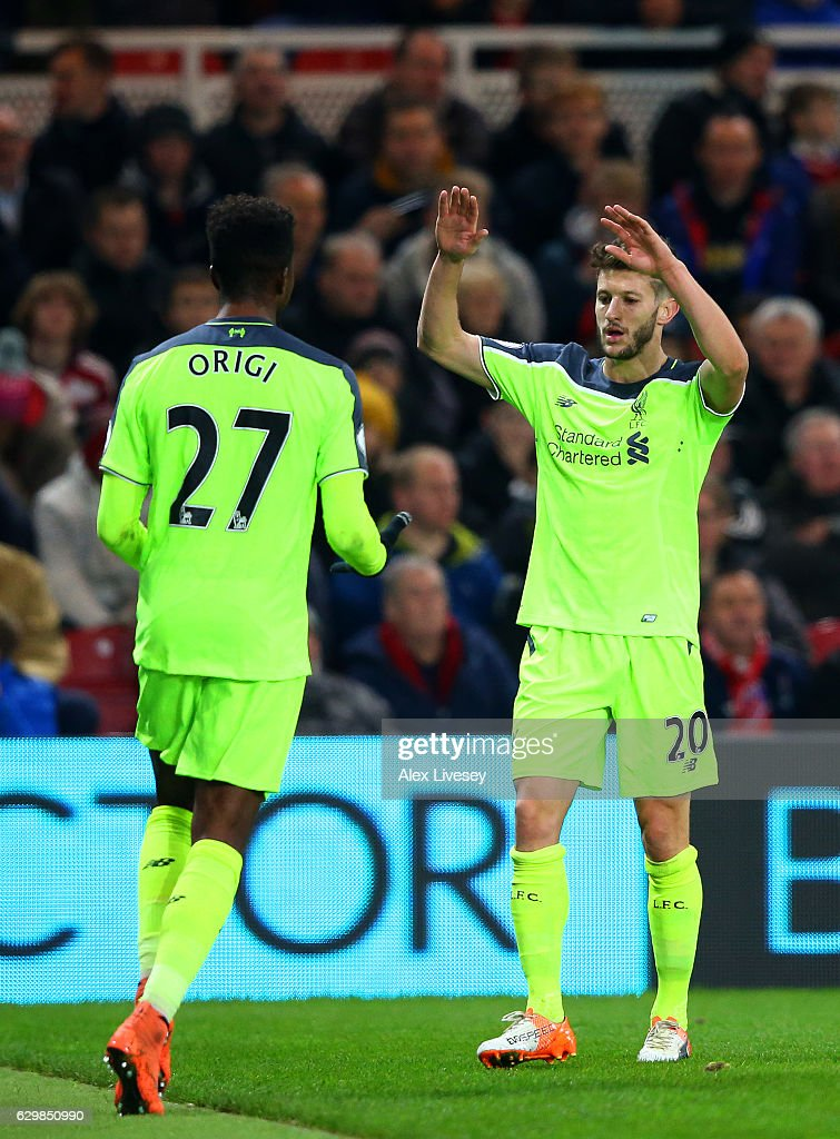 Divock Origi (L) of Liverpool celebrates scoring his team's second goal with his team mate Adam Lallana (R) during the Premier League match between Middlesbrough and Liverpool at Riverside Stadium on December 14, 2016 in Middlesbrough, England.
