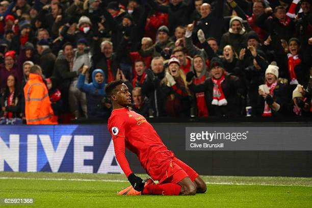 Divock Origi of Liverpool celebrates scoring the opening goal during the Premier League match between Liverpool and Sunderland at Anfield on November...