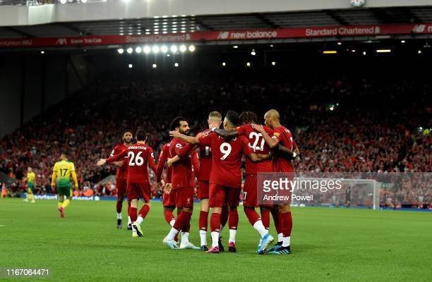 Divock Origi of Liverpool Celebrates the first goal which was a Own Goal during the Premier League match between Liverpool FC and Norwich City at...