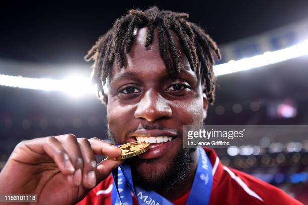 Divock Origi of Liverpool celebrates with his medal after winning the UEFA Champions League Final between Tottenham Hotspur and Liverpool at Estadio...
