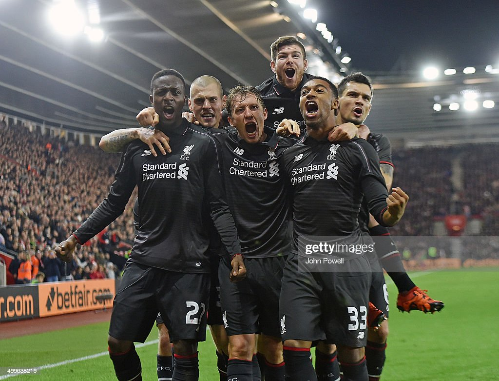 Divock Origi of Liverpool celebrates with his team mates after scoring during the Capital One Cup Quarter Final match between Southampton and Liverpool at St Mary's Stadium on December 2, 2015 in Southampton, England.