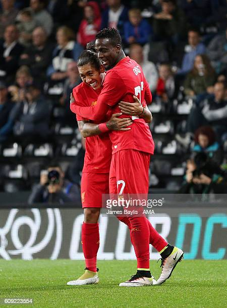Divock Origi of Liverpool celebrates with Roberto Firmino after scoring a goal to make it 03 during the EFL Cup Third Round match between Derby...