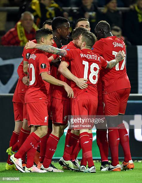 Divock Origi of Liverpool celebrates with team mates as he scores their first goal during the UEFA Europa League quarter final first leg match...